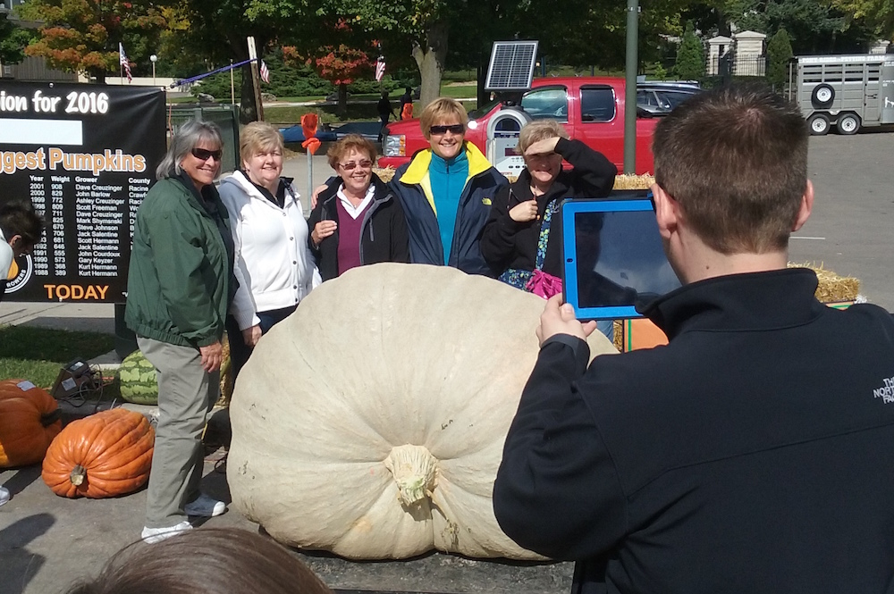 Visitors pose with the winning pumpkin at the 2016 Lake Geneva Oktoberfest contest. Dan Plutchak photo.