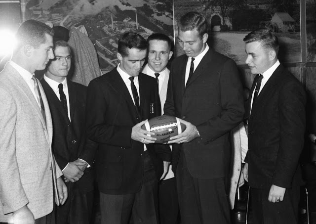 "Left to right includes KHS fullback, Bob Wurdinger, halfback Bruce ""Bucky"" Bay, quarterback Ken Kavanaugh, half back Fred Steger, Bart Starr and guard Pete Bachhuber extra point booting specialist. (Times Photo)"