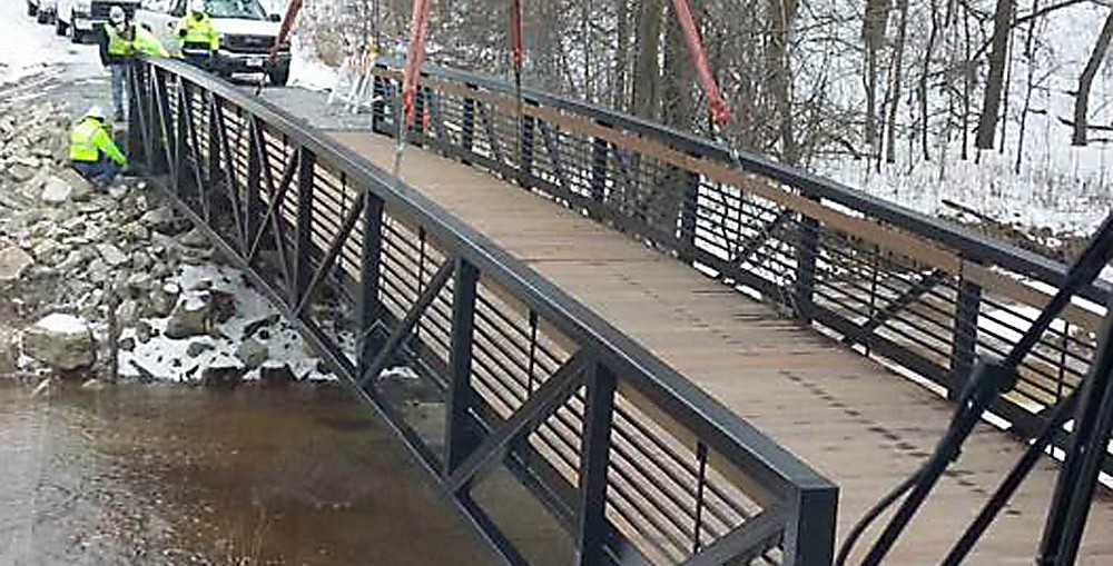 Installation of the new bridge along the Konkapot Trail from the view of crane operator Nathan Van Wychen.