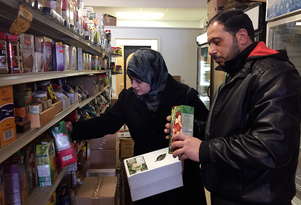 Syrian refugees Rula and Abdul shop at Istanbul Market in Madison, Wis. The couple arrived in Madison on Jan. 20, 2017 with their elementary-age daughters. A week later, President Donald Trump halted any additional arrivals of refugees from the war-torn country indefinitely. They were photographed Jan. 31, 2017. Photo byDee J. Hall / Wisconsin Center for Investigative Journalism