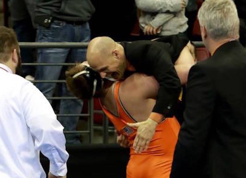 Keaten Kluever hugs his coach after his state championship win. Paul Stumpf photo.