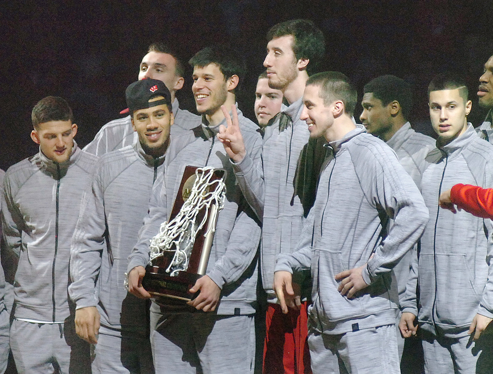 Zak Showalter, left, and Ben Brust, front right, shown here with the UW Bagers 2015 final four team, are expected to make an appearance at the the 2017 Holy Cross Men's Open basketball tournament. Dan Plutchak photo