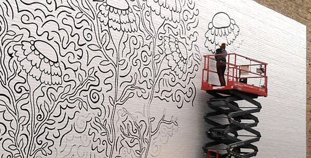 Appleton artist Elyse-Krista Mische begins work on the mural that will be completed April 29, 2017 during Bazaar After Dark. Photo by Tony Penterman.