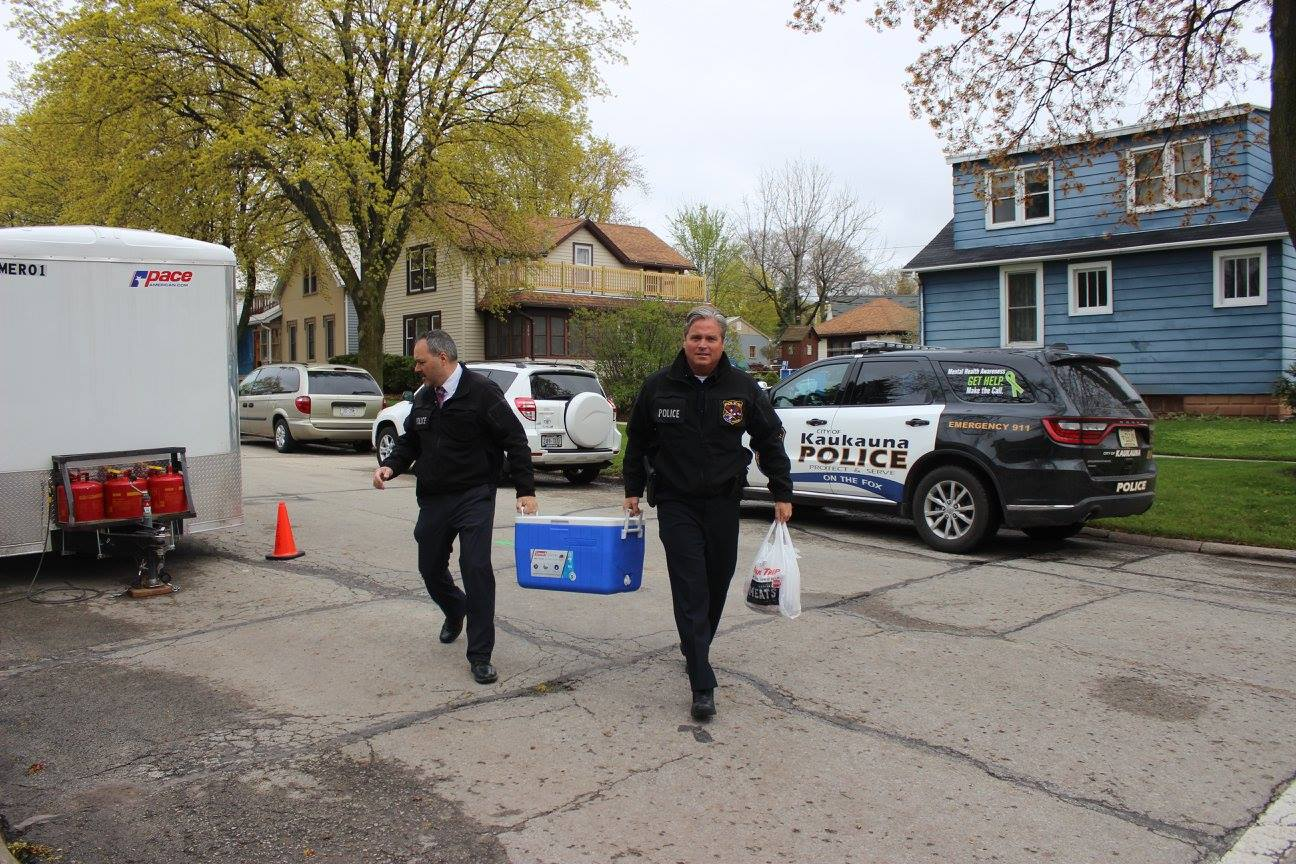 Kaukauna police deliver food to volunteers at the 2017 Rock the Block community build in Kaukauna. Habitat for Humanity photo