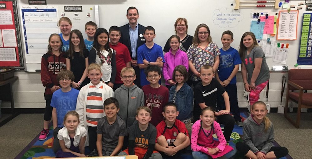 Rep. Mike Gallagher poses for a photo with Mrs. Plutchak's fourth grade class at Electa Quinney Elementary School in Kaukauna. Carrie Forster photo.