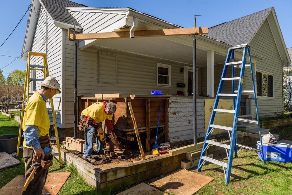 Volunteers work on a project during the the 2017 Habitat for Humanit Rock the Block community build in Kaukauna. Graham Washatka photo