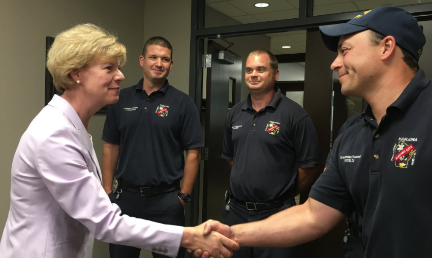 Sen. Tammy Baldwin meets with Kaukauna firefighters May 29, 2018 prior to a roundtable on illegal opioids.