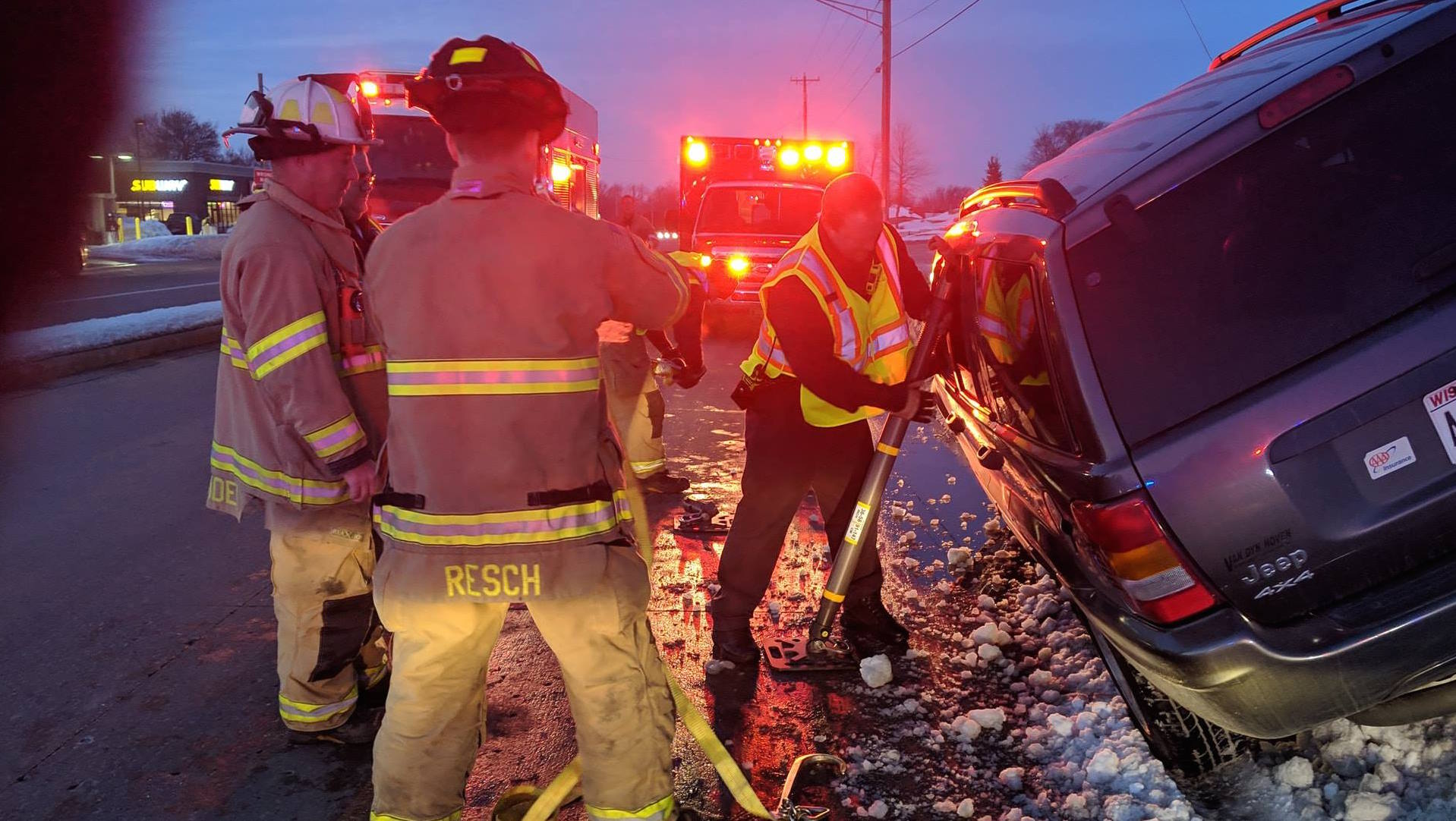 Firefighters work to remove a driver from a vehicle Feb. 22, 2019 on Crooks Avenue in Kaukauna. Kaukauna Fire Department photo
