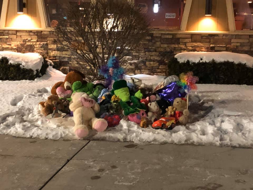 Memorial for Danielle and William Beyer outside of the Kaukauna Pizza Hut. Photo by Jennifer Foust Seefeldt