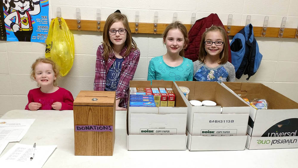 Students at New Directions Learning Center collect donations Feb. 27, 2017 for the birthday box project. Kristin Mceneaney photo.