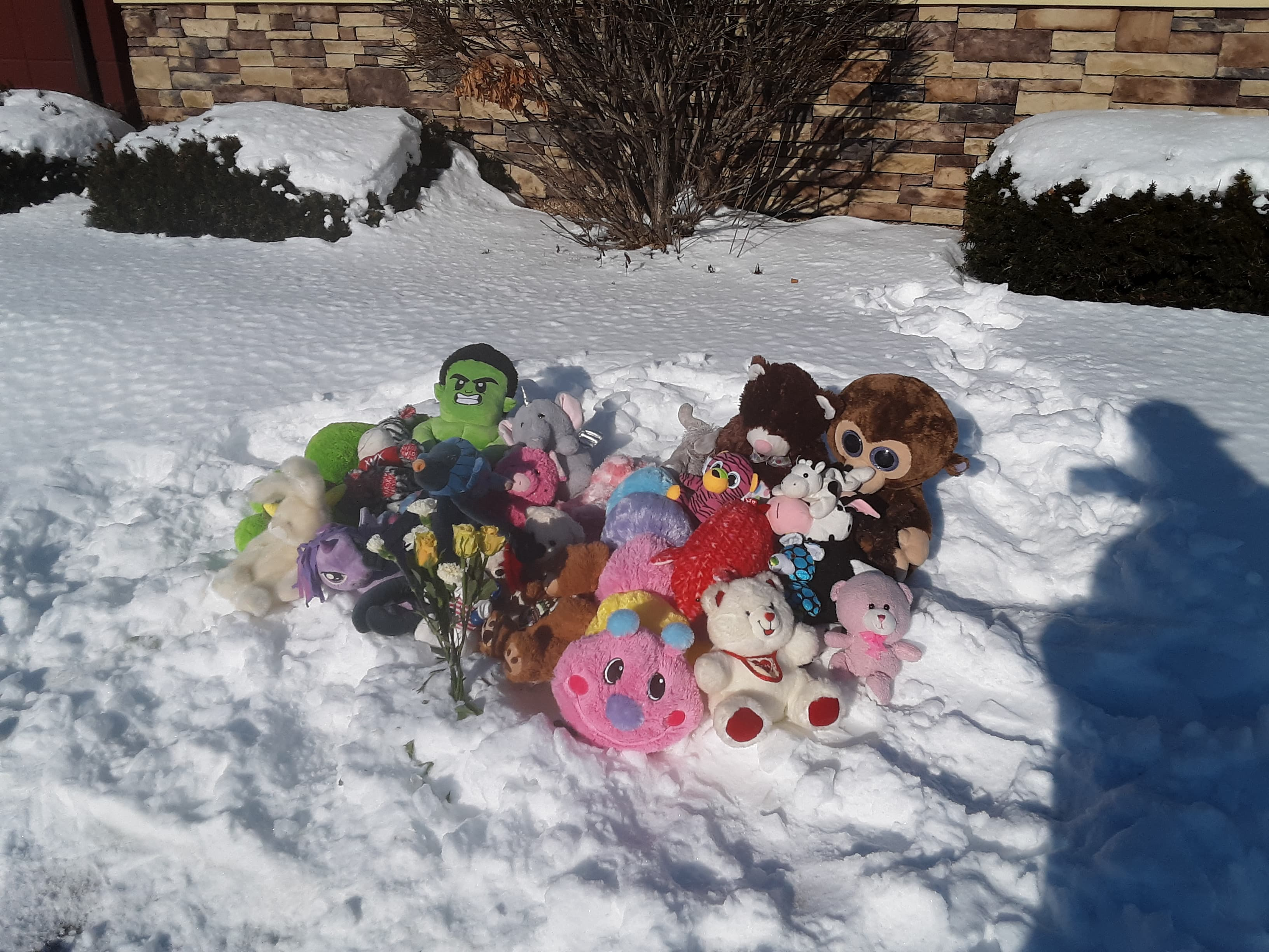 A memorial for William and Danielle Beyer outside of the PIzza Hut in downtown Kaukauna. Tanya Zehren photo