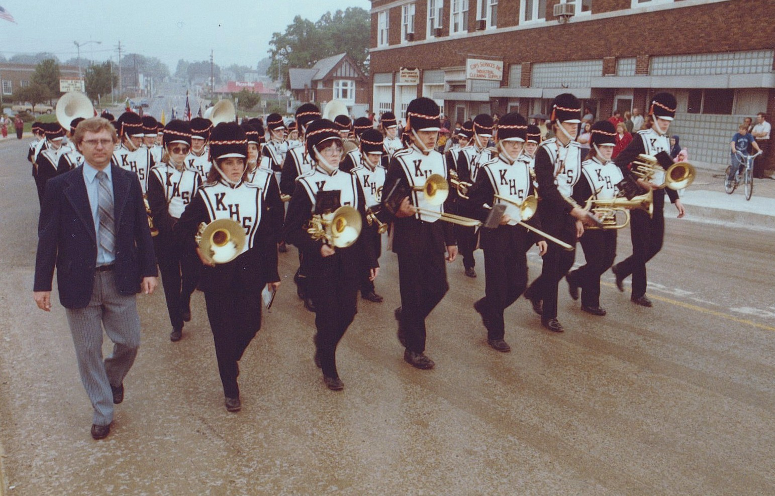 Band director LaVern Lorbiecki leads the Kaukauna High School marching band during the 1984. Memorial Day Parade. Photo by Dan Plutchak.
