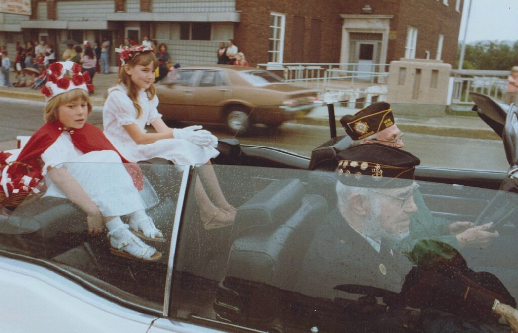 Poppy Princesses wave to the crowd during the 1984 Memorial Day Parade in Kaukauna. Photo by Dan Plutchak.