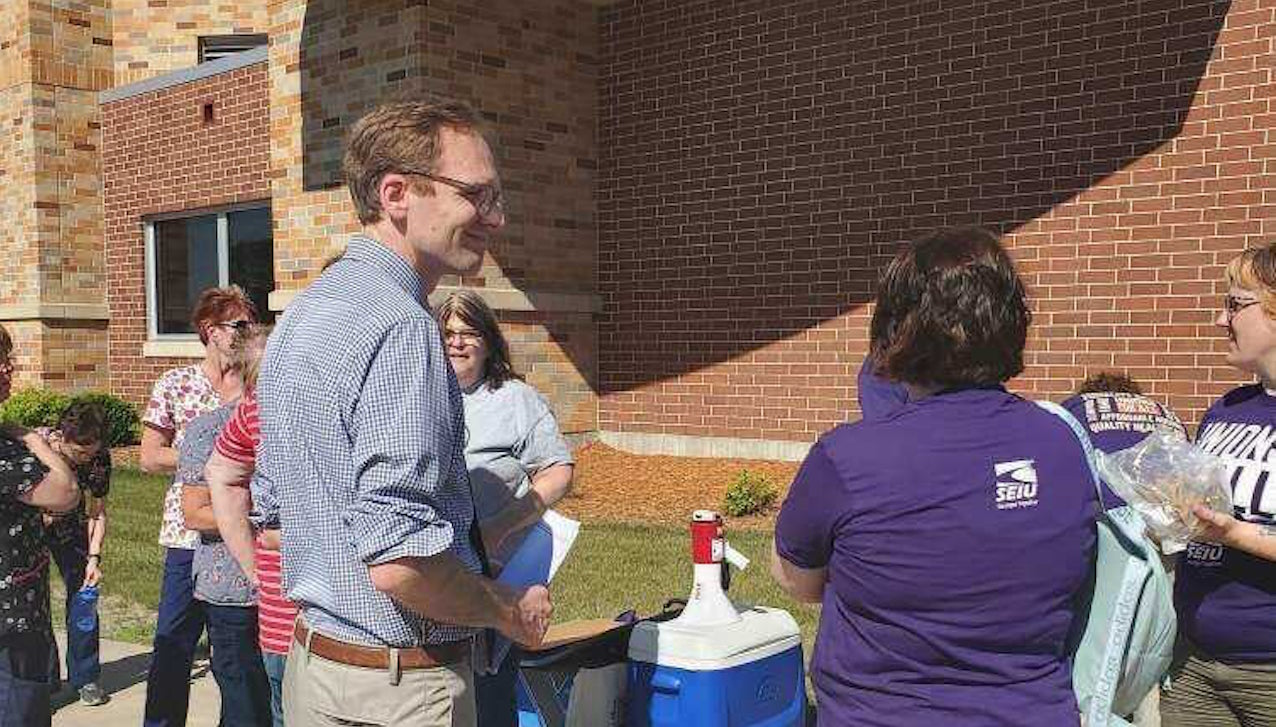 Senate candidate Tom Nelson of Kaukauna rallies with health care workers in Wisconsin Rapids.