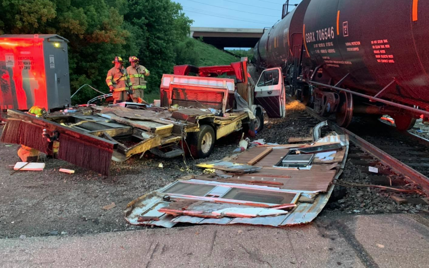No one was injured, but a camper was demolished, when a train plowed into the stalled vehicle near Appleton.